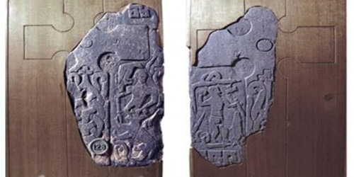 Thorwald's Cross. The left side depicts Norse god Odin battling Fenrir at Ragnarok; the right has Christian iconography (BBC 2018).