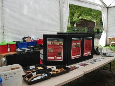 Figure 2: Finds, historical prints and information boards on display in on-site marquee (Image Copyright: Emily Rayner)