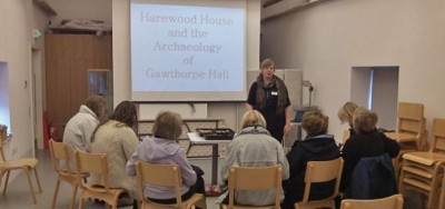 Figure 4: Author giving a talk to members of the Harewood House Trust with finds (Image Copyright: Emily Rayner)