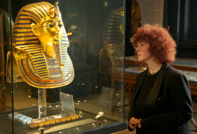 Joann and Tutankhamen's mask in the Museum of Egyptian Antiquities, Cairo (Image Copyright: Blink Television / Dr. J. Fletcher)