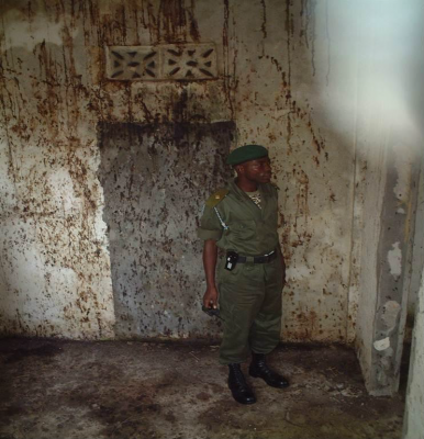 Figure 4: Officer of the recently formed Republic of Sierra Leone Armed Forces examining the Killing House in Kailahun (Reproduced with kind permission of M. Russell)